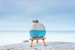 Easel on seashore Stock Image