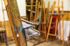Easel smeared with paint. Standing in atelier stock photography