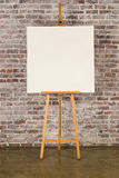 Easel with square canvas Royalty Free Stock Images