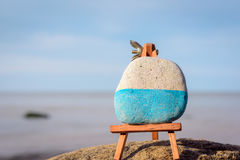 Easel and stone Royalty Free Stock Images