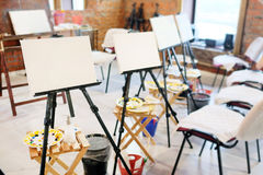 Easel in the studio Royalty Free Stock Photos