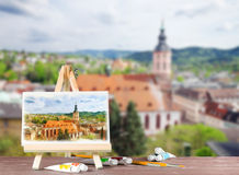 Easel with a watercolor painting with a view of Baden-Baden. Royalty Free Stock Image