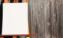 Easel and wood Stock Image
