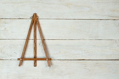 Easel on wooden table. Background with empty easel on wooden table Stock Photography