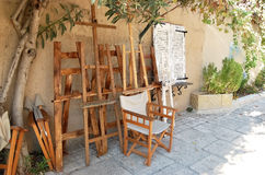 Easels of the artist in the Greek street. Stock Photography