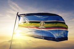 East Africa Community EAC flag textile cloth fabric waving on the top sunrise mist fog. Beautiful royalty free illustration