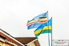 East African Community and Rwandan flags on the border between Rwanda and Democratic republic of congo. Banner country eac emblem flagpole identity nation stock image