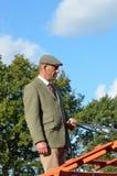 East Anglia Equestrian Fair English countryman holding reins of Carthorse. IPSWICH SUFFOLK  UK  25 October 2014:  East Anglia Equestrian Fair English countryman Stock Photos