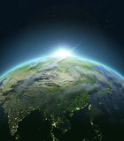 East Asia from space during sunrise. Sunrise above East Asia. Concept of new beginning, hope, light. 3D illustration with detailed planet surface, atmosphere and Royalty Free Stock Image