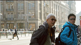 East Asian man and senior travel to Neterlands, Amsterdam. Touri Stock Images