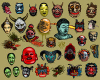 East-Asian masks. Set of East-Asian masks isolated on gray background Royalty Free Stock Images