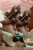 East Asian mythical statuettes on display Royalty Free Stock Photography
