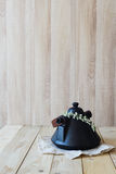 East Asian teapot on linen napkin in wooden interior Stock Images