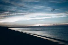 East coast bay shoreline. Blue sky stock images