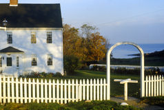 East coast home surrounded by white picket fence,  ME Royalty Free Stock Photos