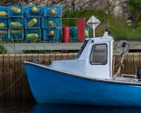 East Coast lobster fishing boat with colorful traps stock image