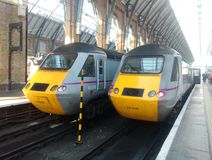 East coast mainline trains at kings cross. Diesel engines at a platform in London railway station Royalty Free Stock Image