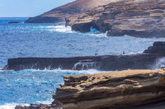 East Coast Oahu. Rugged East Coast of Oahu, Hawaii. Many times tourists and visitors ignore the warning signs and walk out on the slippery rocks Stock Photos