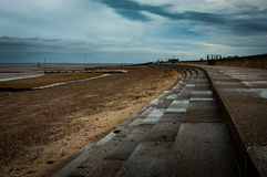 East coast sea defences. And pedestrian promenade with beach and sky Royalty Free Stock Photo
