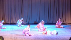 East Dance. DNIPROPETROVSK, UKRAINE - APRIL 2, 2016: Unidentified girls, ages 7-11 years old, perform East Dance at the State Palace of children and youth stock footage