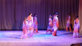 East Dance. DNIPROPETROVSK, UKRAINE - APRIL 2, 2016: Unidentified girls, ages 7-11 years old, perform East Dance at the State Palace of children and youth stock video footage