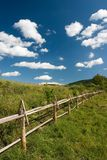 East European summer landscape. East European summer landcape with wooden fence and beautiful clouds royalty free stock photography