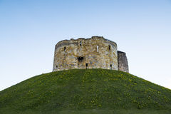 Cliffords Tower. East face of Clifford's Tower, in York, UK. The tower is part of the York castle Royalty Free Stock Photo