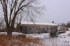 East Fairfield Covered Bridge. In Vermont in winter with frozen river. Built in 1865 Royalty Free Stock Photos