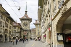 The east front of the Zytglogge in Bern. Bern, Switzerland - April 17, 2017: The east front of the Zytglogge can be seen at the end of a street and many tourists Stock Images