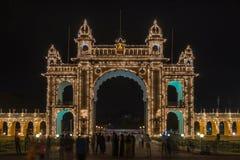 East Gate to Mysore Palace illuminated at night, India. stock photo
