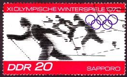 East Germany circa 1972: Cancelled postage stamp printed in East Germany , that shows winter olympic skiing competition in stock image