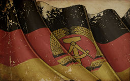 East Germany Flag Old Paper Background Stock Photo