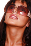 East girl in sunglasses looks in the sky Royalty Free Stock Images