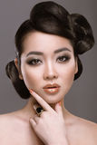 East girl with unusual hairstyle royalty free stock image