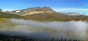 East Glacier Mountain Range with Valley Fog Stock Image