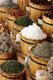 East goods. Wooden capacities cost with spices Stock Image