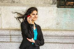 East Indian American college student calling on cell phone outsi Royalty Free Stock Photo