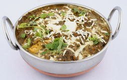 East Indian Dish. An East Indian dish served in a small metal pot with handles on the side Stock Images
