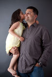 An East Indian girl kisses her father Stock Photography