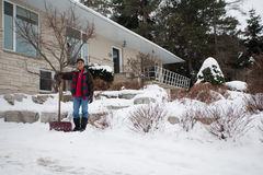 East Indian man shovelling snow Royalty Free Stock Images