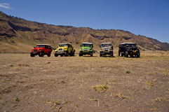 EAST JAVA, INDONESIA-NOV 21 : Colourful jeeps at Blok savana in sunrise light in Bromo Tengger Semeru National Park Royalty Free Stock Image