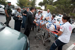 East Jerusalem Riots. EAST JERUSALEM - SEPTEMBER 22: Police and medical personnel aid Israelis injured when their cars were attacked by stone-throwing Stock Photo