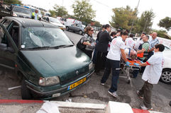 East Jerusalem Riots. EAST JERUSALEM - SEPTEMBER 22: Police and medical personnel aid Israelis injured when their cars were attacked by stone-throwing Royalty Free Stock Photography