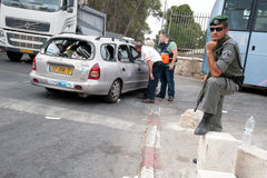 East Jerusalem Riots. EAST JERUSALEM - SEPTEMBER 22: Israeli police and guard the scene after orthodox Jews were injured when their cars were attacked by Stock Images