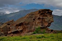 Bizarre rocks in the middle of the vast steppes of Kazakhstan. East Kazakhstan. The uniqueness of Bayanaul in the fact that mountains surrounded on all sides by Royalty Free Stock Image