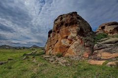 Bizarre rocks in the middle of the vast steppes of Kazakhstan. East Kazakhstan. The uniqueness of Bayanaul in the fact that mountains surrounded on all sides by Royalty Free Stock Photo