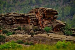 Bizarre rocks in the middle of the vast steppes of Kazakhstan. East Kazakhstan. The uniqueness of Bayanaul in the fact that mountains surrounded on all sides by Royalty Free Stock Photography