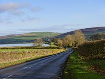 The east Lancashire Moors on the road to Barnoldswick in the beautiful countryside on the Lancashire Yorkshire border in Nort. The Narrow Road that snakes across stock images