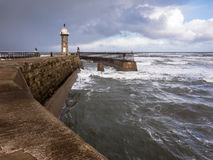 East Lighthouse, and rough sea. In Whitby, North Yorkshire, England. Stock Photos