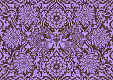 East lilac ornament. East lilac symmetric ornament with birds on a brown background Royalty Free Stock Images